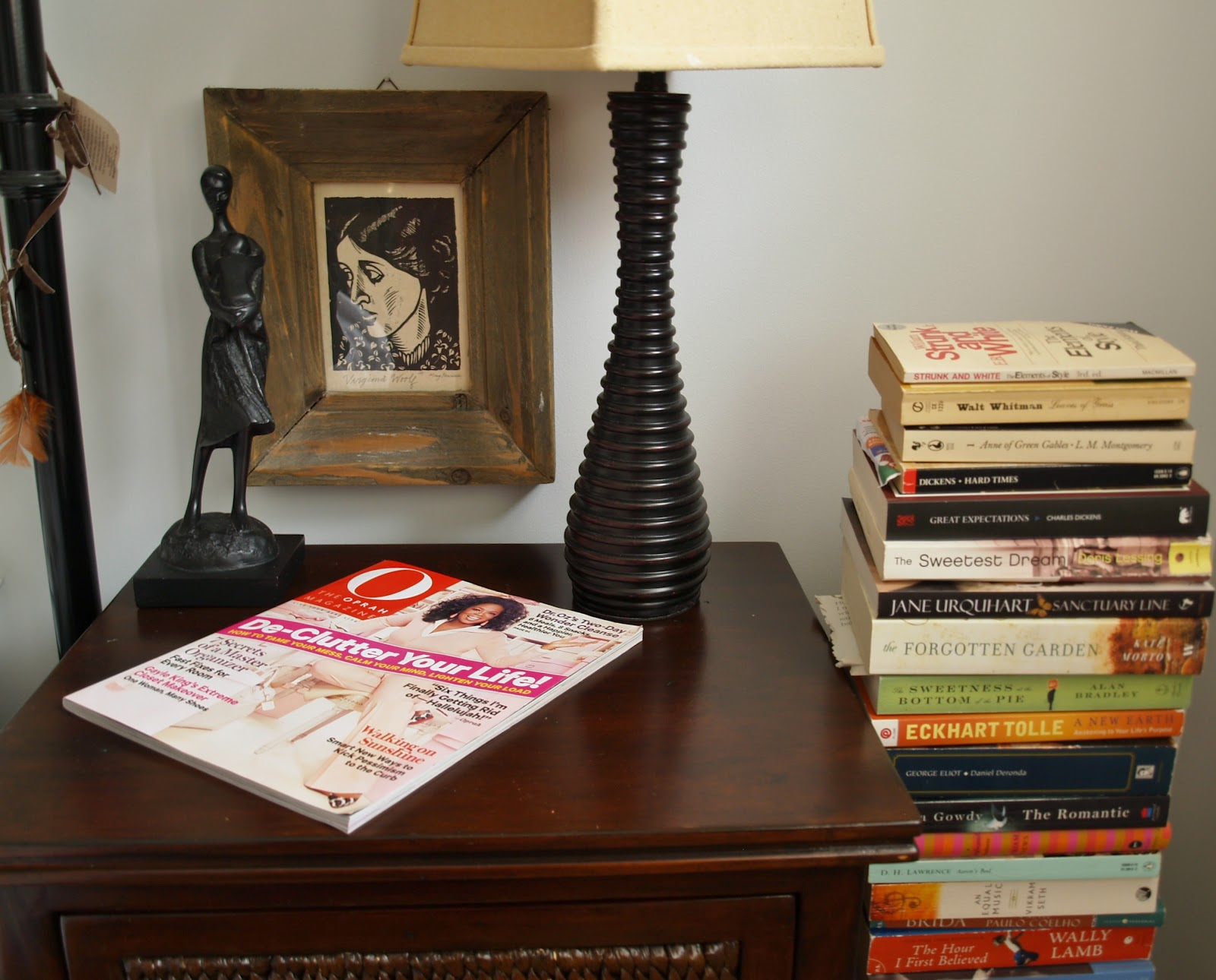 pile of books beside her bedside table via Woman in Real Life