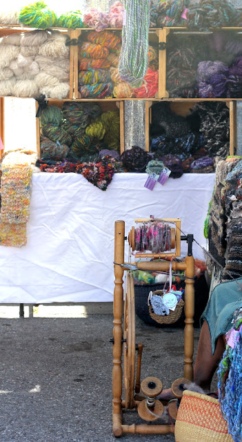 spinning hand dyed yarn at farmers market