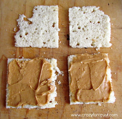Slices of bread covered with peanut butter