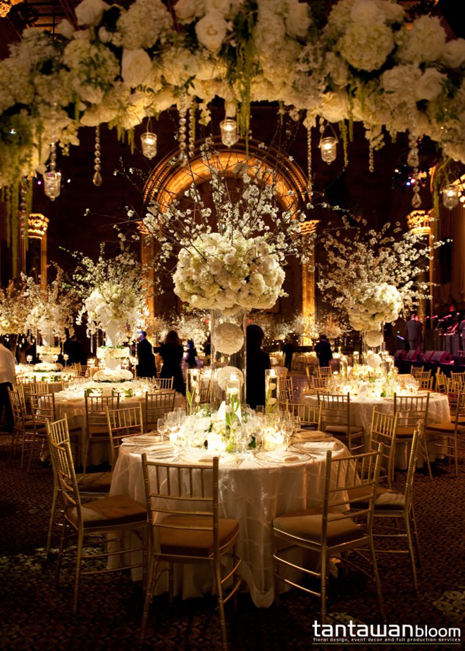 20 Unexpected Wedding Flower Ideas. Start off the reception with a cocktail hour in the foyer and transform the railings into a floral masterpiece. Vines of greenery, bushels of roses, scattered petals, candles and overhead bistro lighting make for a ridiculously impressive entrance (and not to mention an amazing wedding cake display.