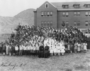 Aboriginal students and staff assembled outside the Kamloops Indian Residential School