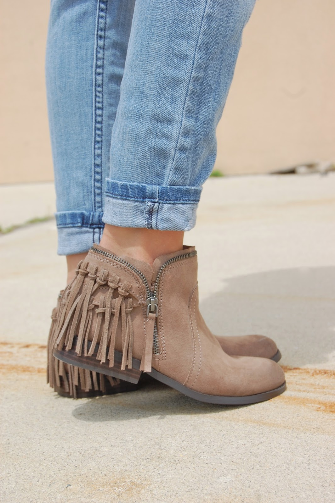wearing a white tee, distressed boyfriend jeans, floppy hat and fringe Dolce Vita fringe ankle booties, casual look
