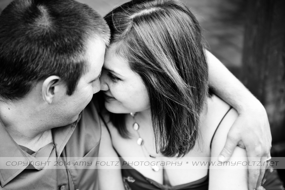 black and white photo of couple cuddling