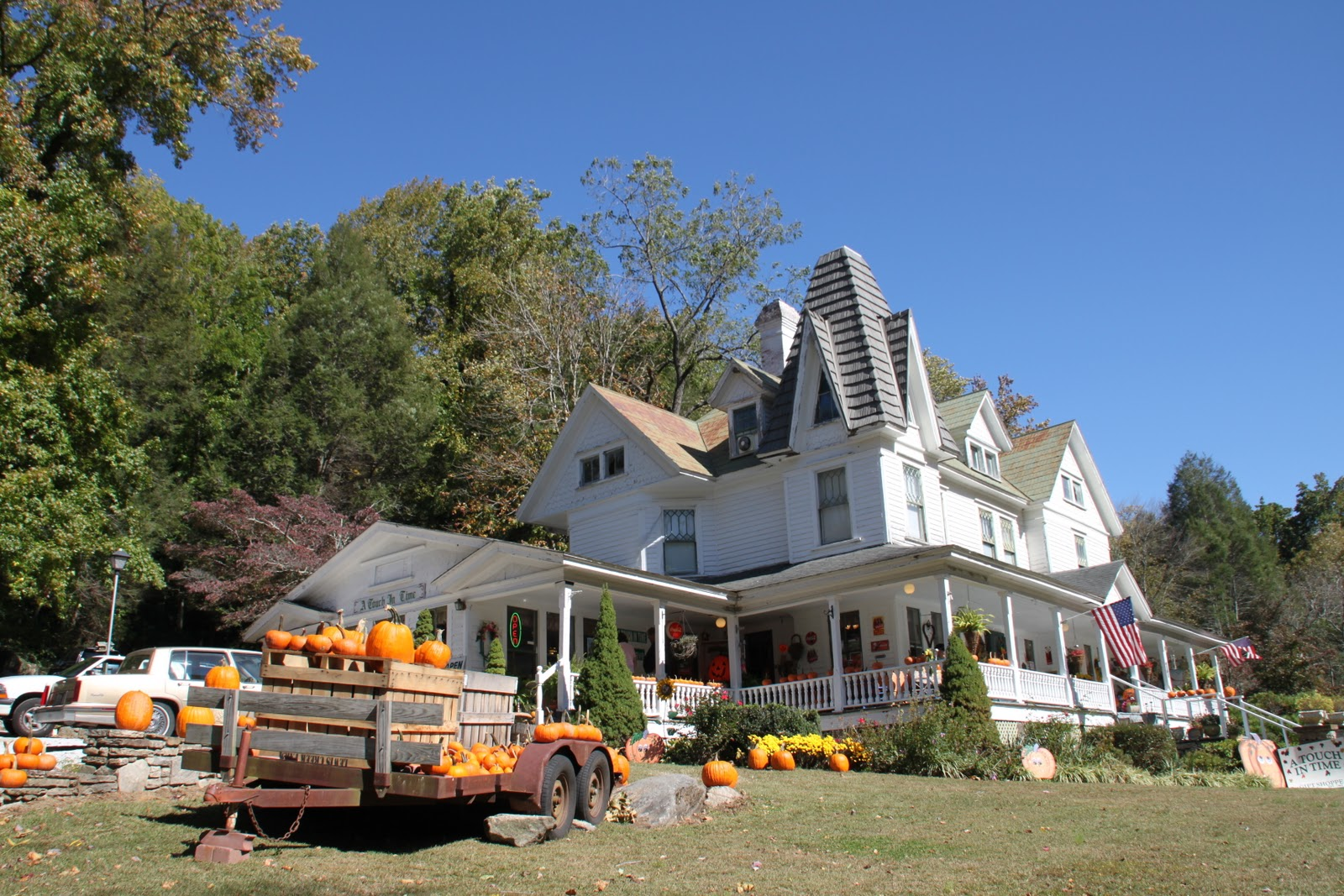 One of my favorite places is this wonderful old building housing the gift shop a touch in time the front porch beckons with a line of pumpkins on the