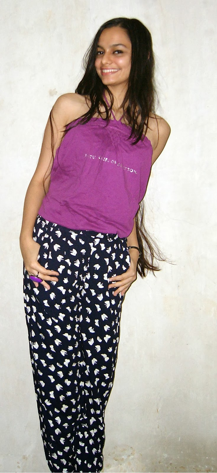 how to wear printed trousers, butterfly print pants, mauve top, statement ring