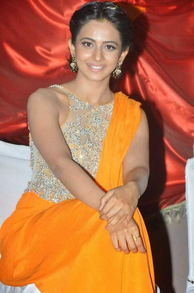 Actress Rakul Preet Singh In Orange Saree Gown