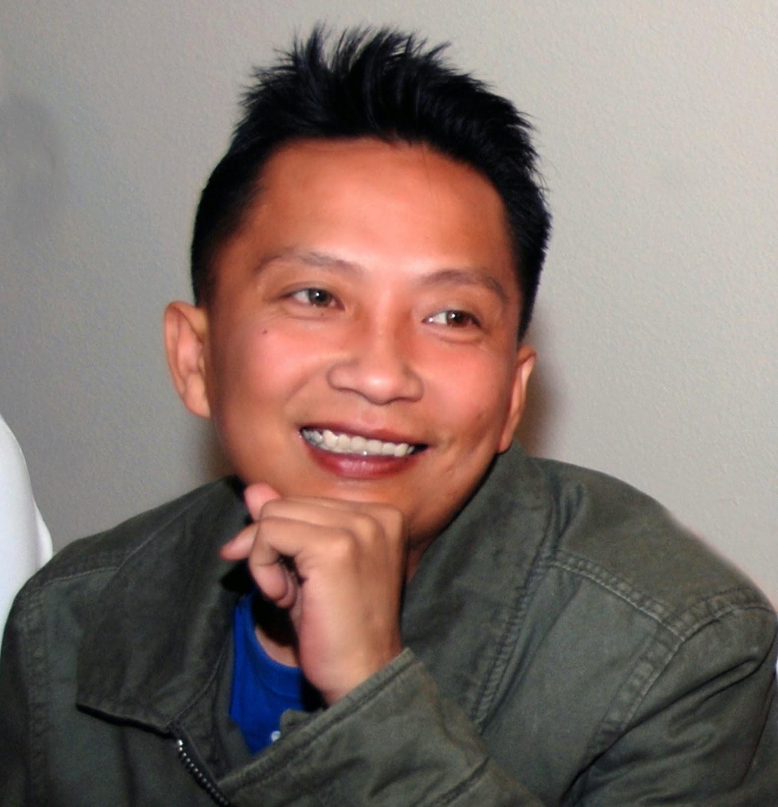 A smiling Quan Nguyen.  Photo credit: Luan Nguyen.