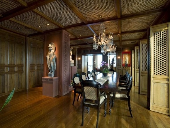 Photo of huge luxury Thai designed dining room with wood everywhere