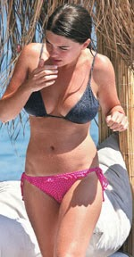 With her slim body and Light brown hairtype without bra (cup size 32B) on the beach in bikini