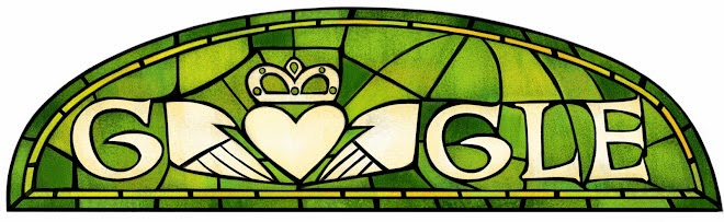 The Google Logo made from green stained glass with a heart and crown decorating it.