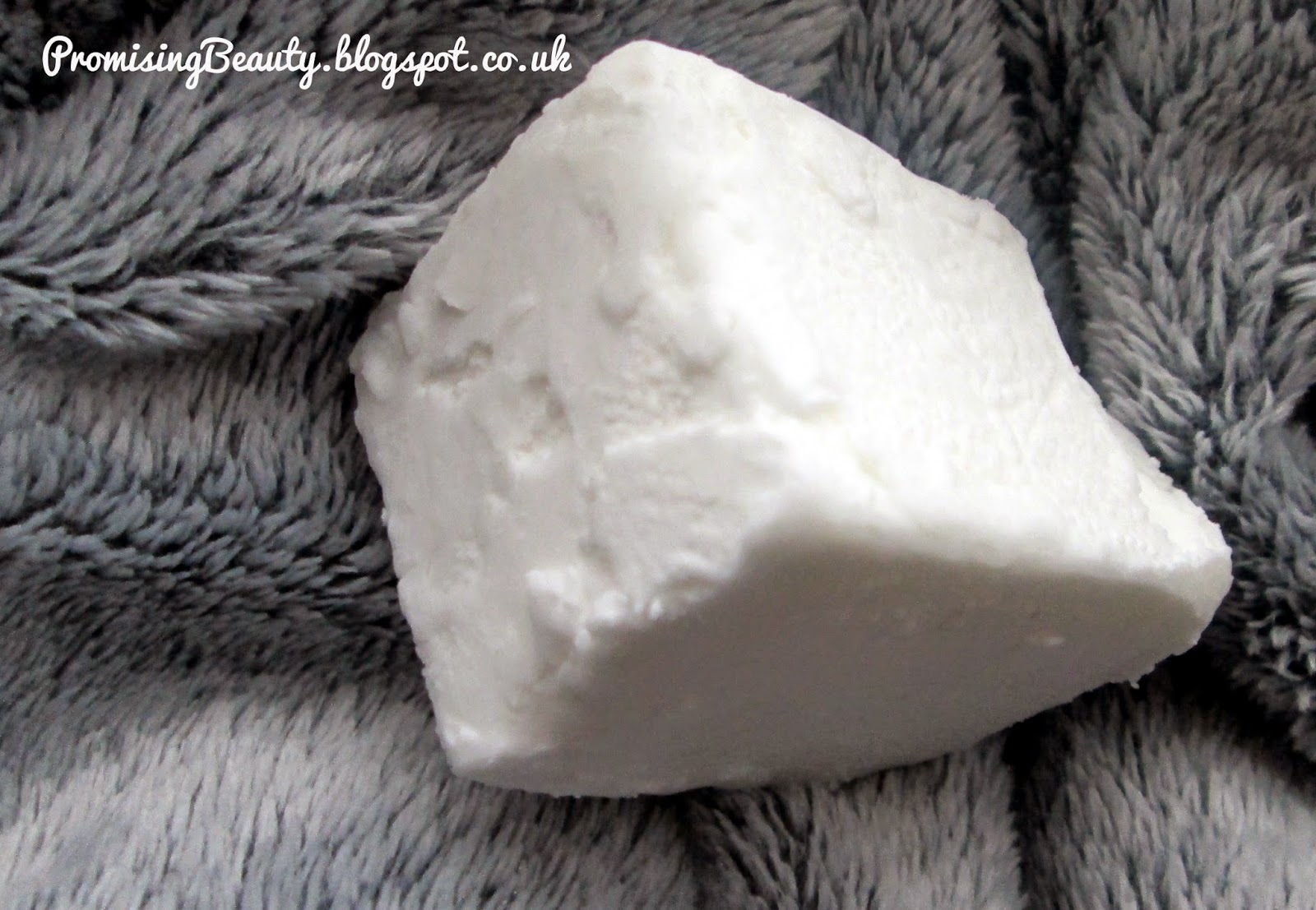Block of solid coconut oil. White chunk of coconut oil from naissance.