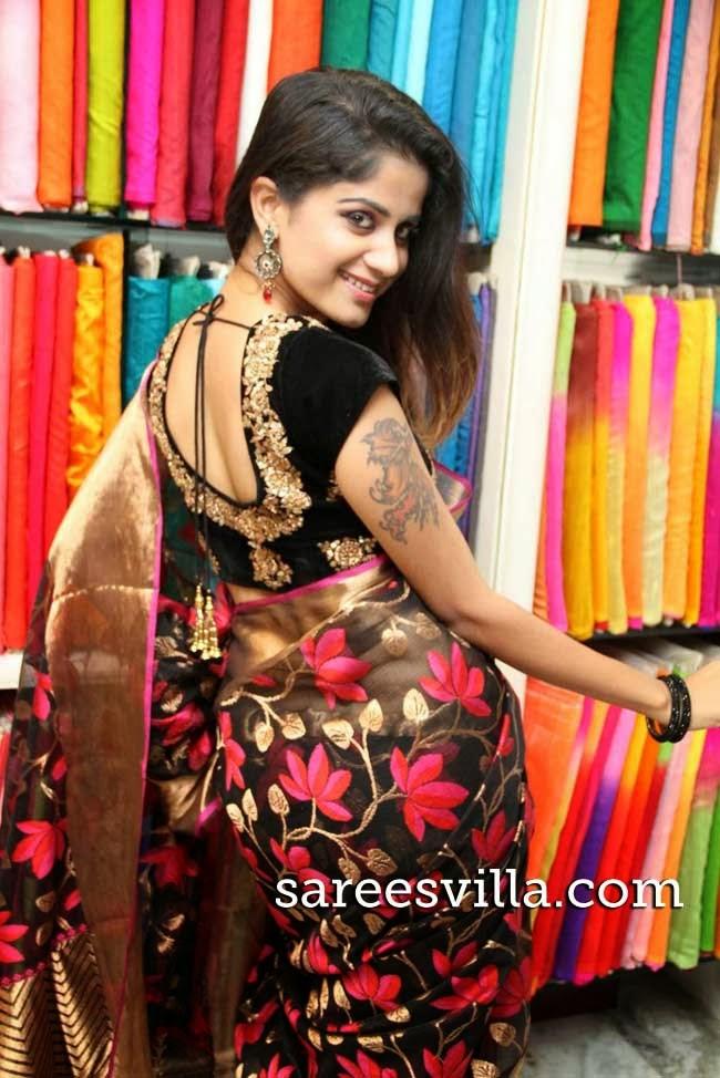 Model in black kota saree