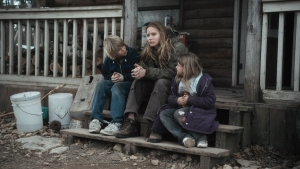 Jennifer Lawrence (center) stars as Ree Dolly in WINTER'S BONE