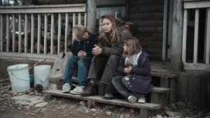 Jennifer Lawrence (center) stars as Ree Dolly in WINTER'S BONE