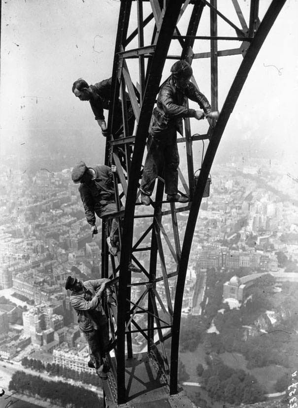 These 15 Incredibly Rare Historical Photos Will Leave You Speechless - Painting the Eiffel Tower, 1932.
