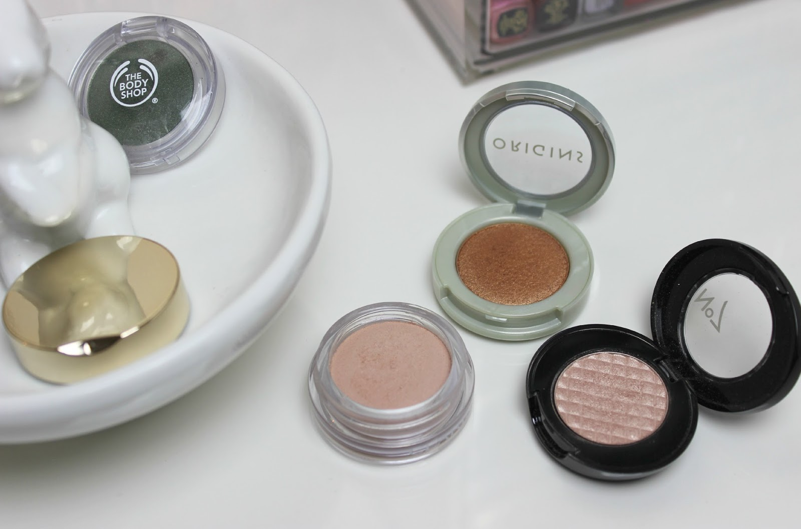 A picture of Origins Peeper Pleasers Powder Eye Shadow, No7 Stay Perfect Eyeshadow and Clarins Ombre Matte Cream-to-Powder Matte Eyeshadows