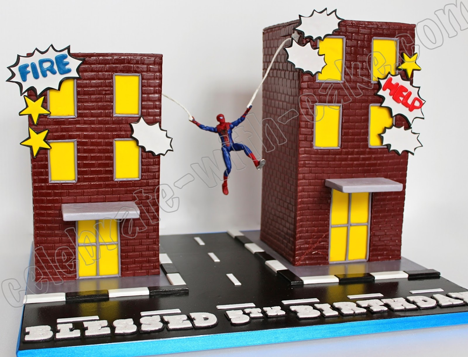 celebrate with cake spiderman buildings cake