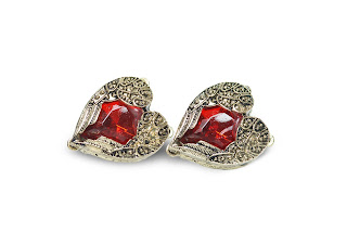 a pair of winged studs encase a red stone