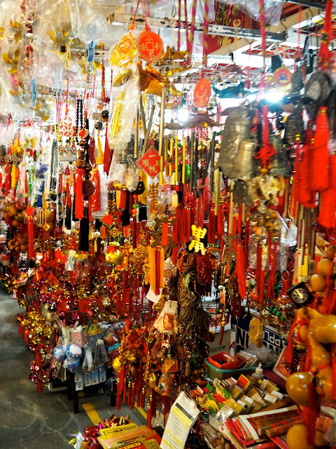 Colourful Chinese souvenirs for sale outside Sik Sik Yuen Wong Tai Sin Temple, Hong Kong