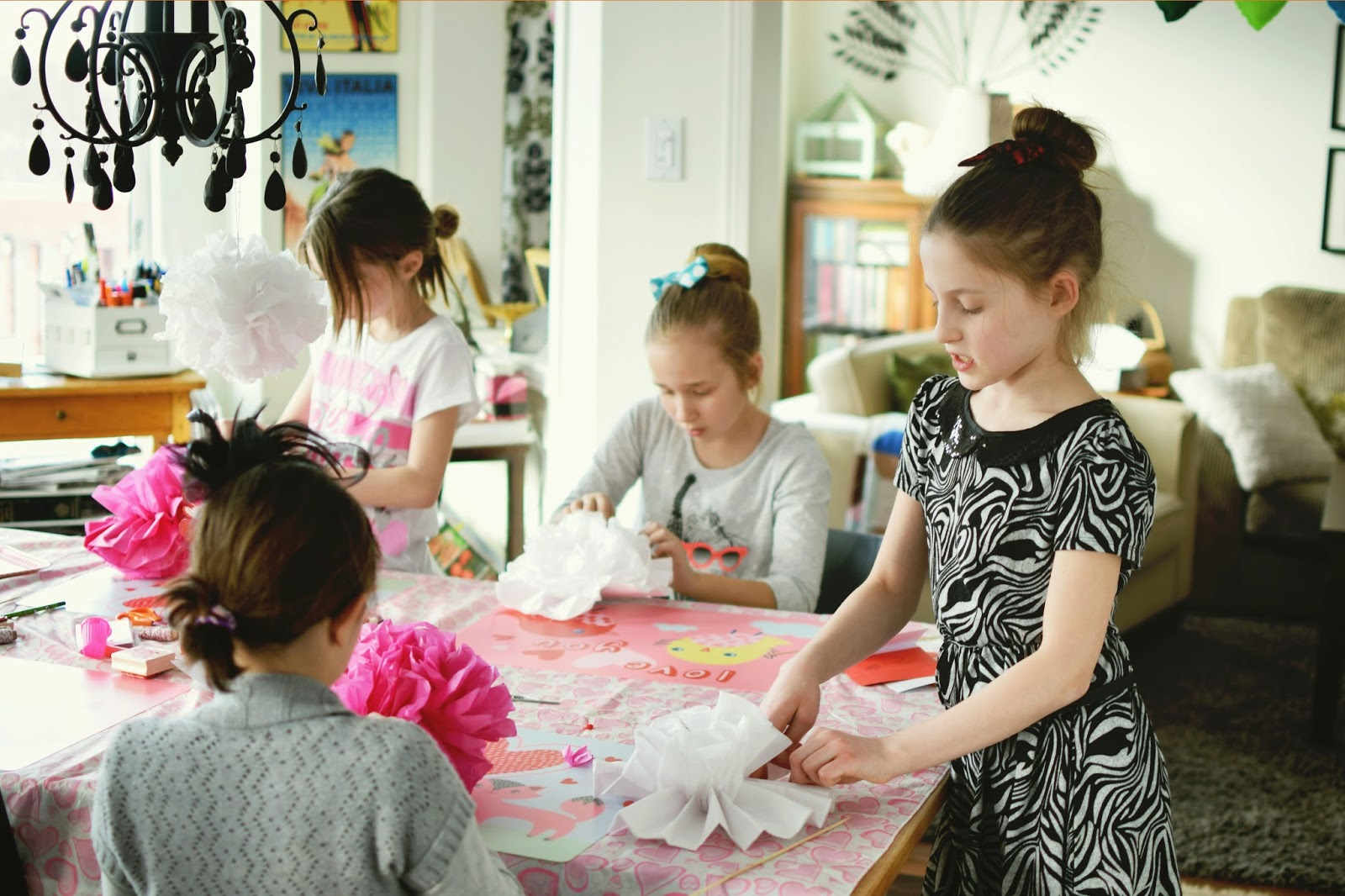 Making tissue paper pom poms for Valentine's Day