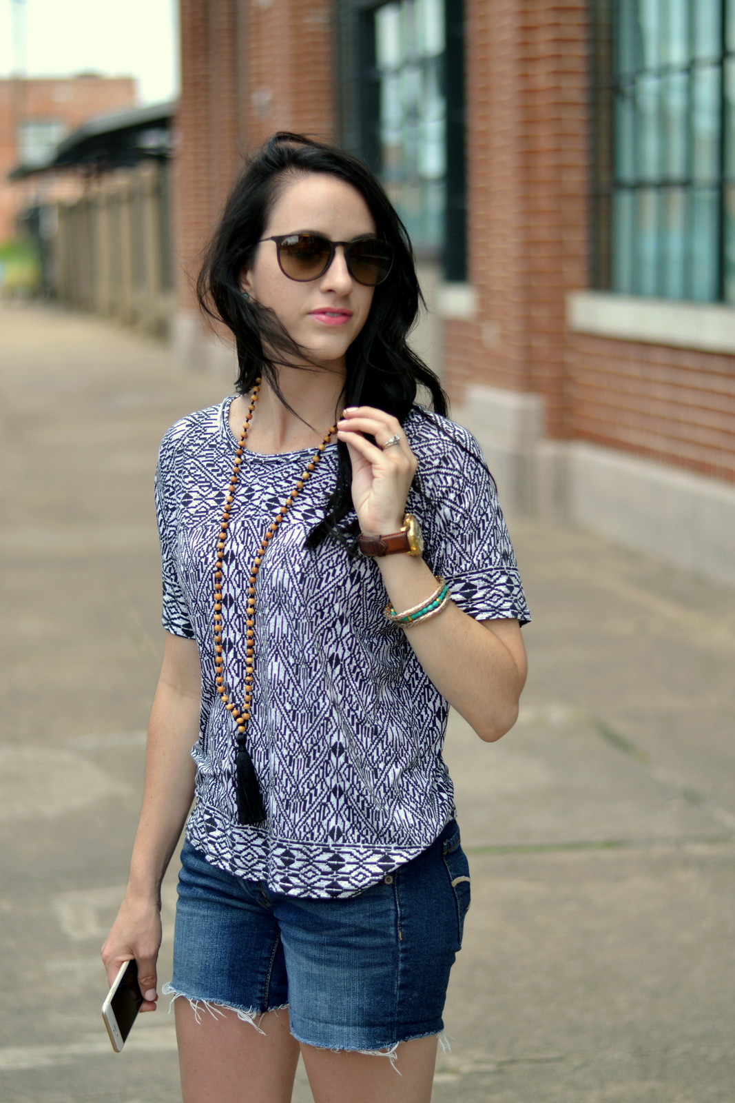 aztec printed tee and tassel necklace