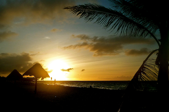 image of the sunrise at the beach in front of the Fusion Hotel in Playa Del Carmen, Mexico