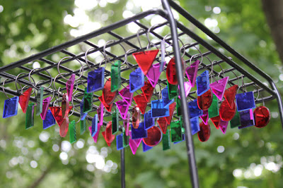 multicolored plastic prisms hanging from a metal rack