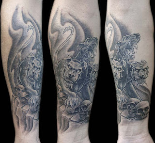 fore arm tattoo: Cerberus, the guardian of the Underworld