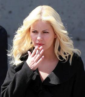 Elisha Cuthbert Smoking Cigarettes