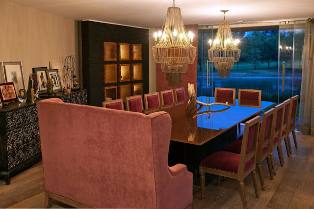 Luxury dining room with red chairs