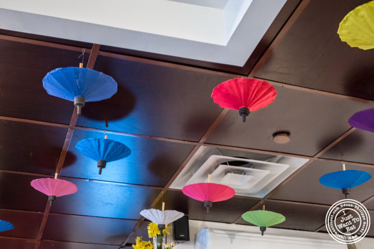 image of umbrellas at Larb Ubol, Thai restaurant in Hell's Kitchen, NYC, New York