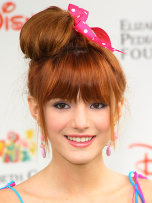 Bella Thorne adds some fun to her lopsided bun with a bright pink bow