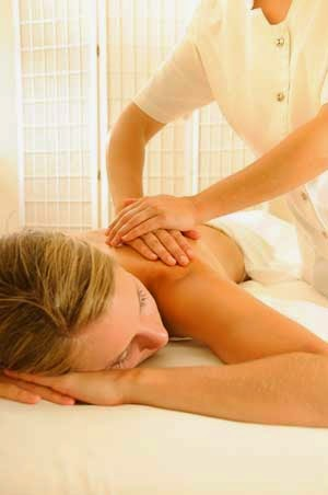 Woman receiving a massage after starting her exercise program