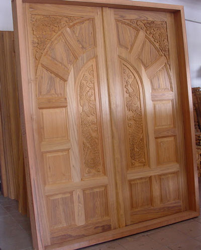 Wood design ideas new kerala model wooden front door for Double door wooden door