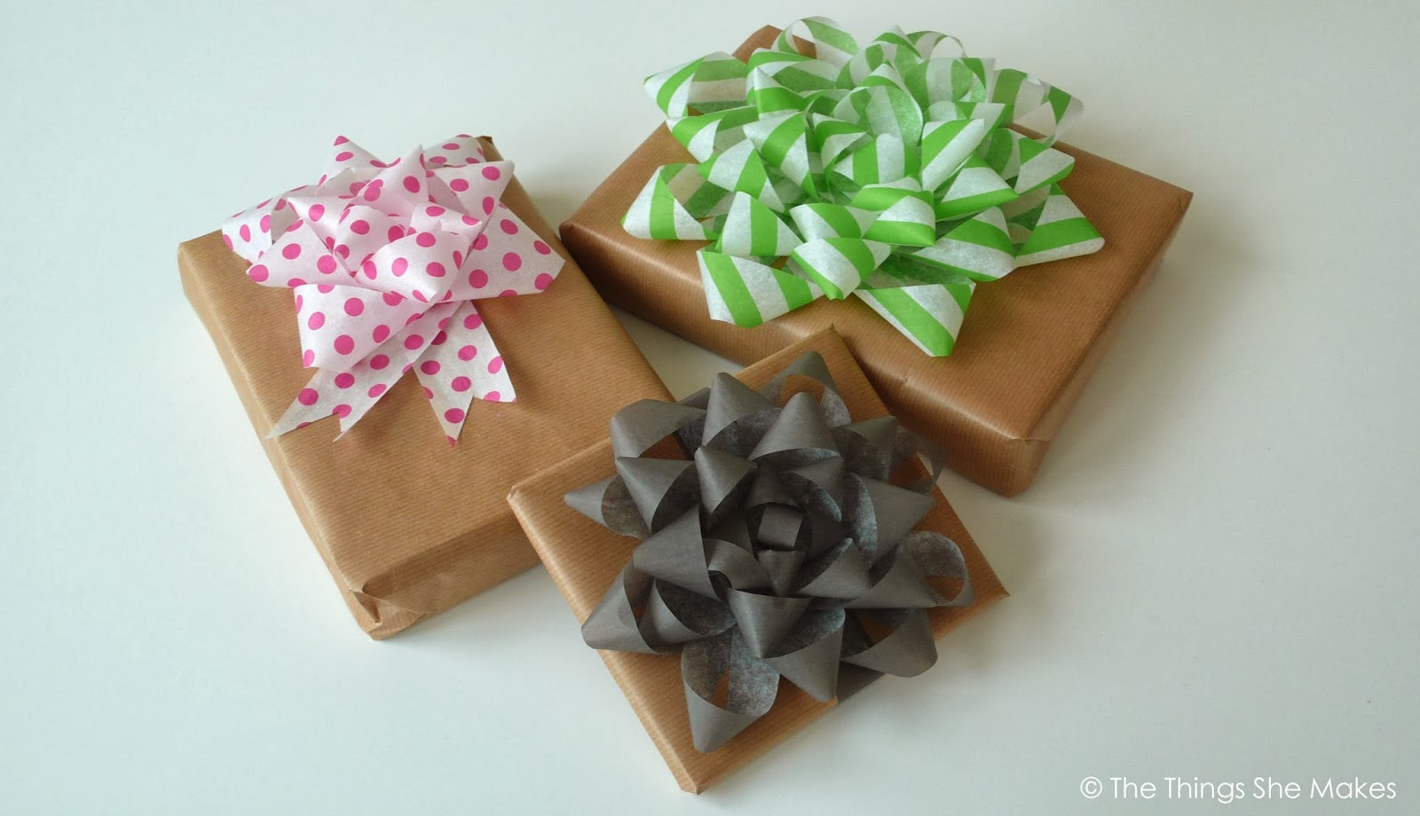 giant present bows made from coloured and patterned paper