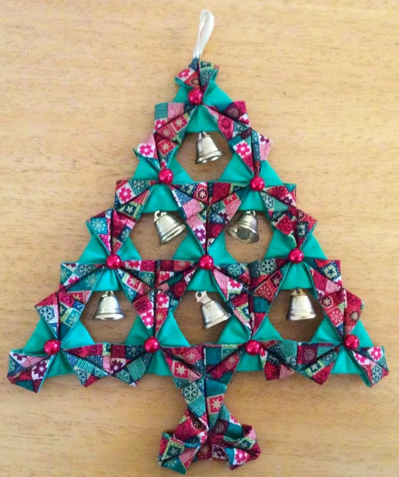 http://nannynotes2u.blogspot.com.au/2014/11/make-fabric-origami-xmas-tree.html