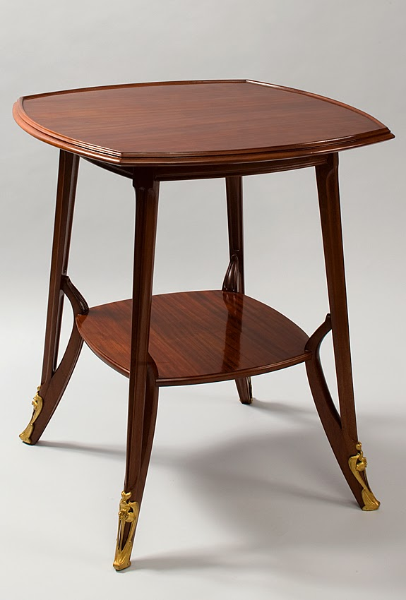 A French Art Nouveau walnut and mahogany table by Louis Majorelle