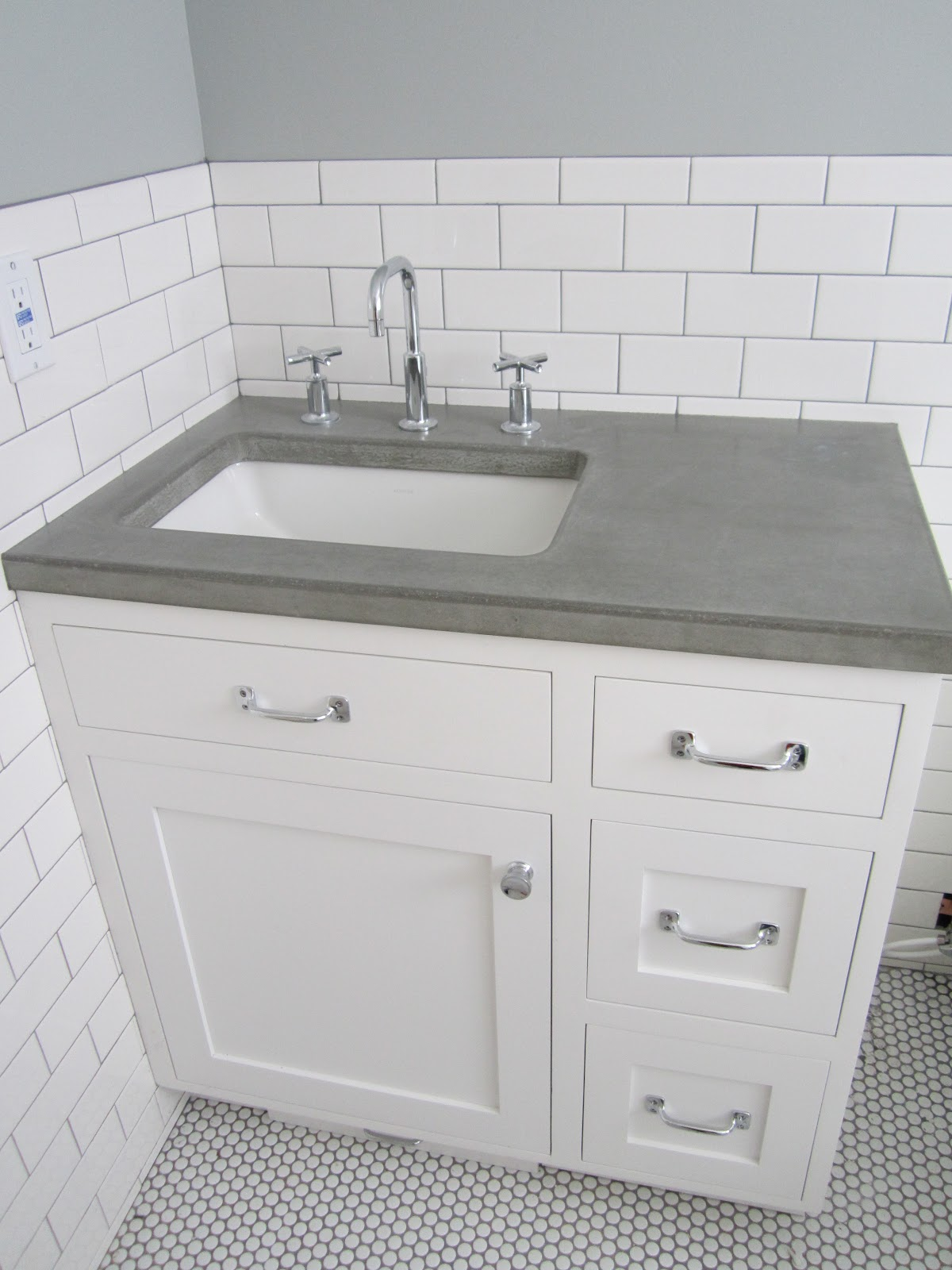 Loving my new concrete counter top Mike from Just Add Water did a fab job  more. Bathroom Item Starting With J