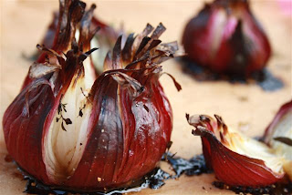 whole roasted red onions with herbs
