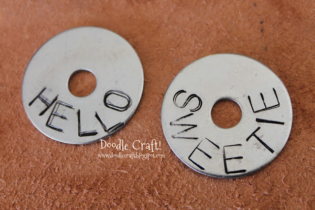 http://www.doodlecraftblog.com/2013/07/hand-stamped-metal-washers.html