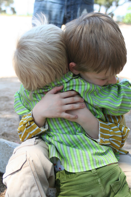 Matti and Anton hugging both wearing Marimekko shirts.