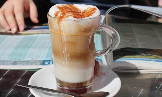 Caramel macchiato on plate with dribble down side