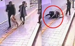 The terrifying moment a pavement swallows two South Korean pedestrians.