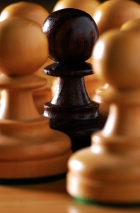 a black pawn among white