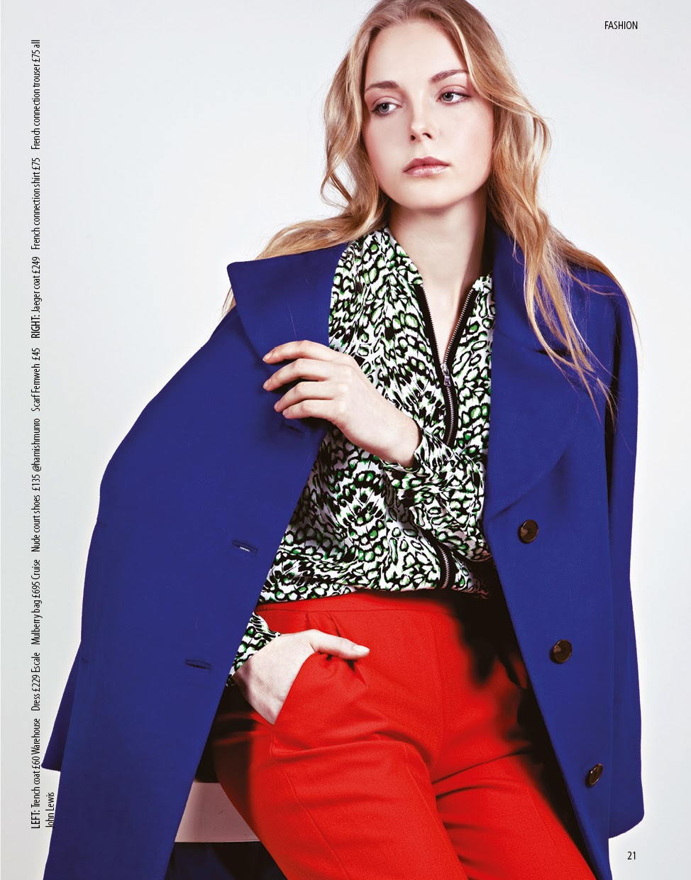model wears bright blue coat for fashion shoot, with loose textured hairstyling