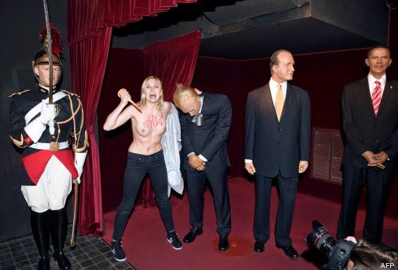 Femen décapitant le petit Tsar poutine au Musée Grévin (Fr)