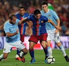 Manchester City - F.C. Barcelona, disputando un partido en Manchester