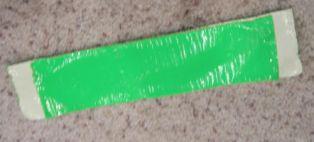 2 lakban di isi karton untuk guard samping