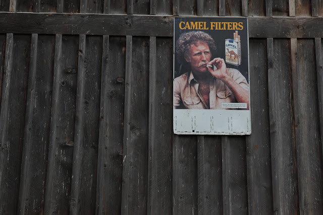 An old Camel Filters cigarette ad hanging on a barn in western Oregon.