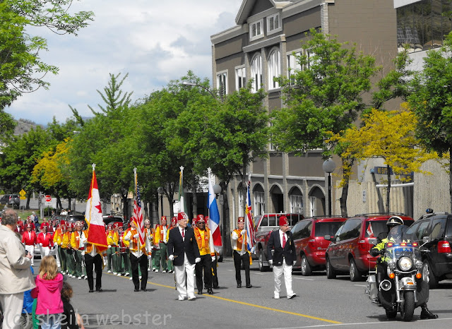 The Shriners carry the flags in the parade includine the National flag of Canada